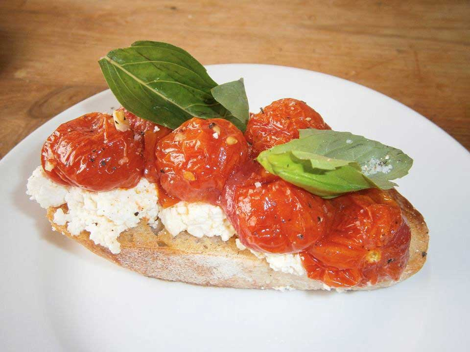 Bruschetta with fresh ricotta and roasted tomatoes